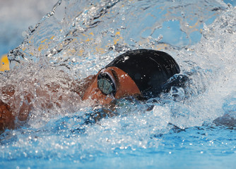 China's Tang Yi swims in the women's 100m freestyle heats during the World Swimming Championships at the Sant Jordi arena in Barcelona
