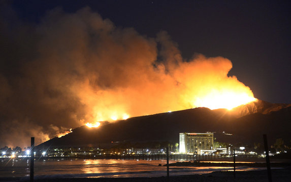 Huge flames light up the coast line the Solimar brush fire that started early Saturday morning in Ventura County