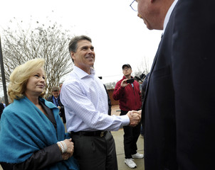 Rick Perry and his wife Anita greet supporters during a campaign stop in Pickens