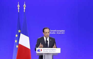 France's President Hollande addresses a news conference during an EU leaders summit in Brussels