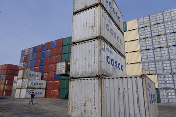 File picture of containers from COSCO at a port in Shanghai
