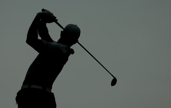 Rory McIlroy of Northern Ireland is silhouetted as he hits his tee shot on the 12th hole during the second round of the 2014 PGA Championship at Valhalla Golf Club in Louisville