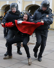 Russia's Interior Ministry officers detain opposition activists during a protest rally defending Article 31 of the Russian constitution, which guarantees the right of assembly, in St. Petersburg
