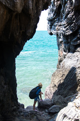 Travel women in a cave near the sea in Keo Sichang, Thailand