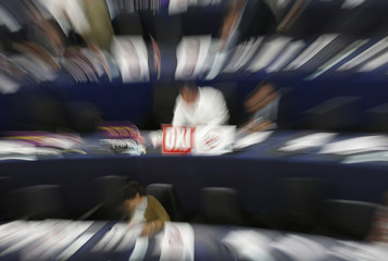 """A poster with the word """"No"""" is seen on the desk of a member of the European Parliament after a voting session in Strasbourg"""