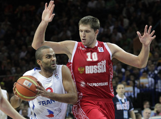 Parker of France is challenged by Khryapa of Russia during their FIBA EuroBasket 2011 semi-final basketball game in Kaunas