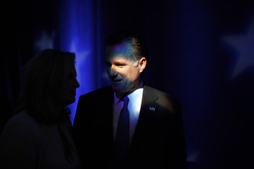 Republican presidential candidate former Massachusetts Governor Mitt Romney talks with his wife Ann during a break in a Republican presidential candidates debate in Myrtle Beach