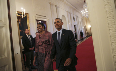 First lady Michelle Obama and U.S. President Obama arrive prior to Presidential Medal of Freedom ceremony at the White House in Washington