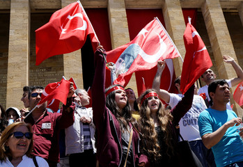 People wave flags and shout slogans as they visit Anitkabir during a Youth and Sports Day celebration in Ankara