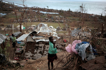 A girl looks back in an area destroyed by Hurricane Matthew in Les Anglais