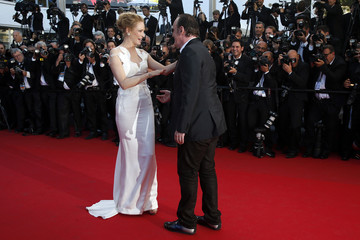 Director Quentin Tarantino and actress Uma Thurman pose on the red carpet as they arrive at the closing ceremony of the 67th Cannes Film Festival