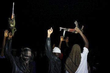 Armed vigilantes holds AK-47 before they patrol in the center of Bujumbura, Burundi