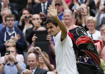 Roger Federer of Switzerland celebrates after defeating Novak Djokovic of Serbia in their men's semi-final tennis match at the Wimbledon tennis championships in London