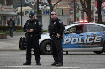 Detroit Police Officers stand along Woodward Avenue during a May Day protest against the Detroit Emergency Manager and the municipal Bankruptcy in downtown Detroit, Michigan