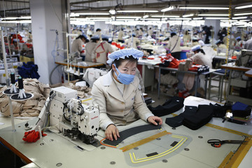 A North Korean employee works in a factory of a South Korean company at the Joint Industrial Park in Kaesong industrial zone