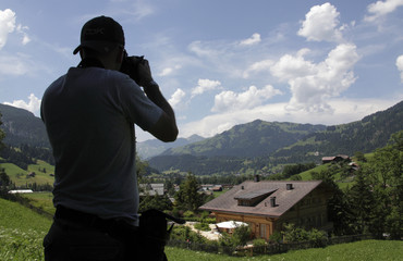 """A photographer takes a picture of film director Roman PolanskiÕs chalet """"Milky Way"""" in the Swiss mountain resort of Gstaad"""