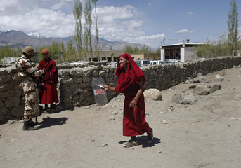 A Buddhist monk arrives to cast his vote at a polling station in Ladakh