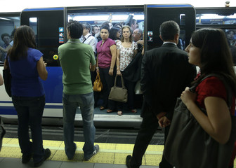 Passengers stand inside a metro during a strike in Madrid