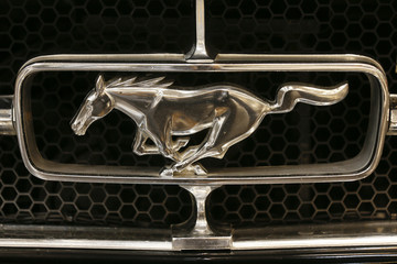 The logo of a vintage Ford Mustang is pictured at the Essen motor show