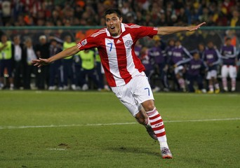Paraguay's Cardozo celebrates after scoring the winning penalty after a penalty shootout in their 2010 World Cup second round soccer match in Pretoria