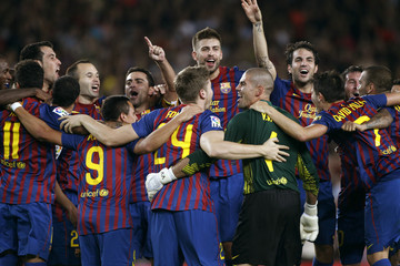 Barcelona's players celebrate their victory against Real Madrid at the end of their Spanish Super Cup second-leg soccer match at the Camp Nou stadium in Barcelona