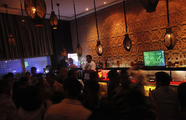 Partygoers dance inside the i-Bar, popular with middle and upper class Indians, in Bangalore