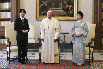Pope Francis poses with Japan's Prince Akishino and his wife Princess Kiko during a meeting at the Vatican