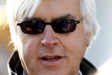 Trainer Bob Baffert talks with the media about his horse Kentucky Derby early favorite Lookin at Lucky  after his early morning workout at Churchill Downs in Louisville