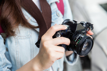 Young asian lady holding her camera