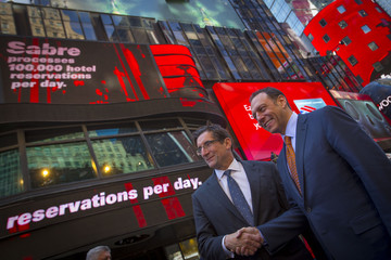 CEO of the Nasdaq-OMX Stock Market Robert Greifeld and Tom Klein, Chief Executive Officer and President of Sabre Corporation pose for photos following the opening of trading at the NASDAQ MarketSite in Times Square in celebration of Sabre Corporation's ini