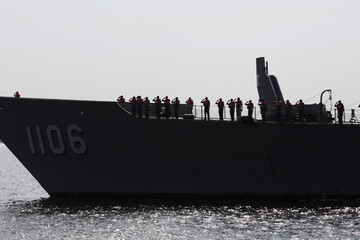 Taiwanese Naval crewmen salute upon arrival at Corinto port, west of Managua