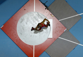 Eaton of the U.S. competes during the men's shot put heptathlon event at the world indoor athletics championships at the ERGO Arena in Sopot