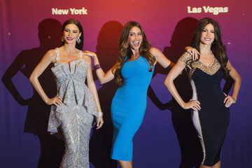 Vergara poses for photographers with wax likenesses of herself during unveiling at Madame Tussauds wax museum in New York