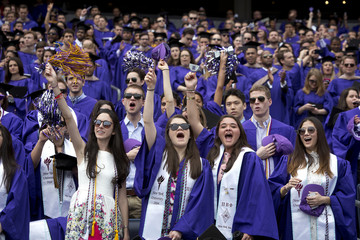 Graduates from New York University cheer during the commencement ceremony at Yankee Stadium in the Bronx borough of New York
