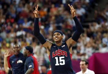 Anthony of the U.S. celebrates after a made three-point basket against Argentina during their men's basketball semifinal match at the North Greenwich Arena during the London 2012 Olympic Games