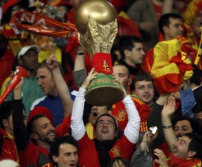 Spain's soccer fans celebrate their victory over Portugal after the 2010 World Cup second round soccer match at Green Point stadium in Cape Town
