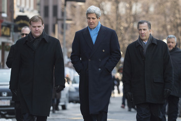 U.S. Secretary of State Kerry walks with Canadian Foreign Minister Baird and Mexican Foreign Secretary Meade to the Union Oyster House for a working lunch in Boston