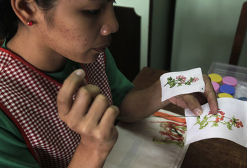 A student worker creates cross stitch designs for greeting cards at the Good Shepherd convent in Baguio city