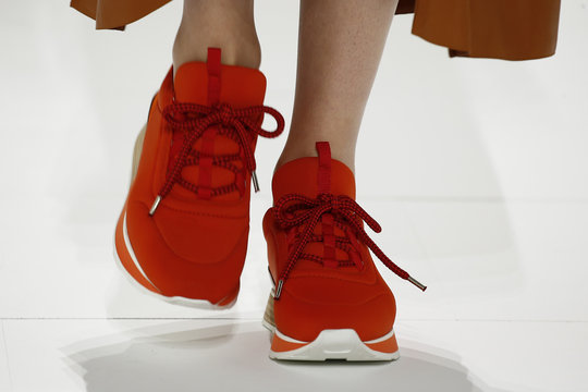 A model presents a shoes creation by French designer Nadege Vanhee-Cybulski as part of her Spring/Summer 2016 women's ready-to-wear collection show for fashion house Hermes in Paris