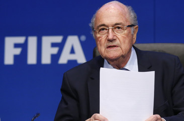 Re-elected FIFA President Blatter arrives for a news conference after an extraordinary Executive Committee meeting in Zurich