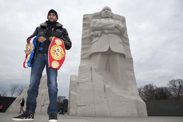 Boxing champion Amir Khan of Britain poses for pictures at the Martin Luther King Memorial in Washington