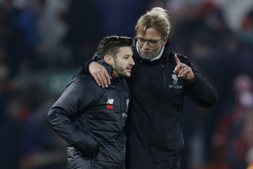 Liverpool manager Juergen Klopp celebrates with Adam Lallana at the end of the match