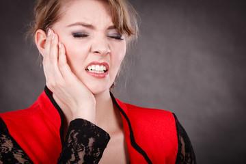 Negative emotion. Woman having tooth ache.