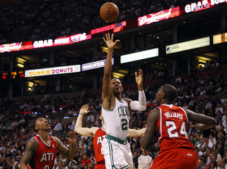 Boston Celtics guard Ray Allen shoots amid Atlanta Hawks guard Jeff Teague and Atlanta Hawks forward Marvin Williams during the second quarter of Game 3 of their NBA Eastern Conference playoff basketball series in Boston