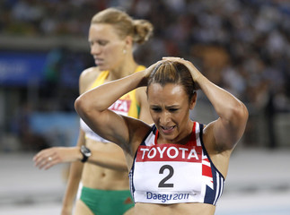 Heptathlon second place finisher Jessica Ennis of Britain walks with her hands on her head at the end of her 800 metres event in Daegu