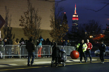 The Empire State Building is seen in the background as shoppers line up outside Target before the store opens in Newport