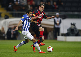 Eintracht Frankfurt's Meier challenges Porto's Sandro during their Europa League soccer match in Frankfurt