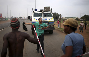 Protesters  take part in a service delivery protest in Sebokeng, south of Johannesburg
