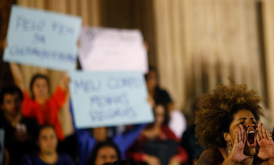 Demonstrators attend a protest against rape and violence against women in Rio de Janeiro,