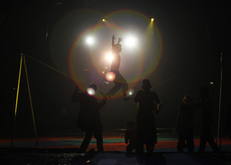 An artist from the U.S. performs during a show at the Rambo Circus in Mumbai